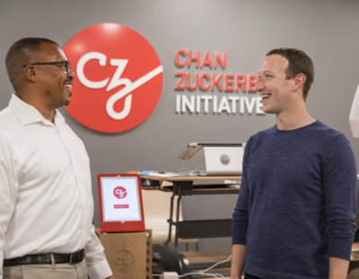 Aly Tamboura laughing with Mark Zuckerberg in the Chan Zuckerberg Initiative offices.