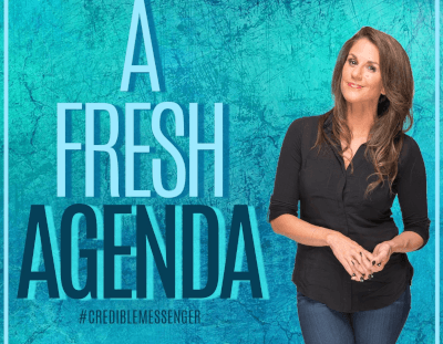 Christina Mendosa standing next to A Fresh Agenda logo.